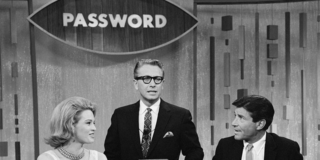 "Angie Dickenson and Efrem Zimbalist, Jr. join host Allen Ludden (center) on the CBS game show ""Password,"" on Jan. 13, 1965. (Photo by CBS via Getty Images)"