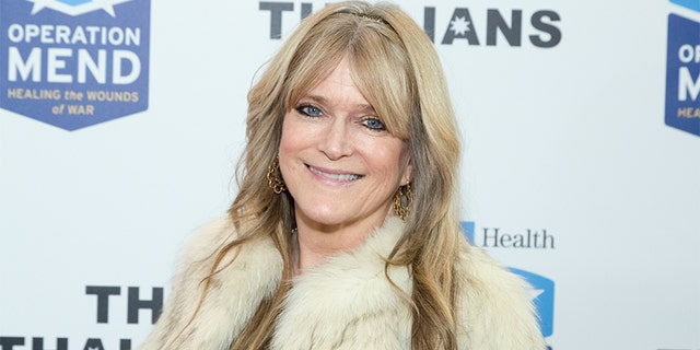 Susan Olsen attends The Thalians Holiday Party with President Kira Reed Lorsch Chair at Bel-Air Country Club on December 1, 2018, in Los Angeles, California.