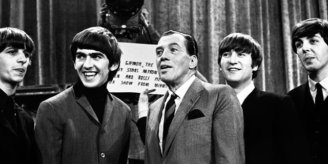 Ed Sullivan with The Beatles, before the group's second appearance on 'The Ed Sullivan Show' on Feb.y 16, 1964 at the Deauville Hotel in Miami Beach, Fla. (Photo by Jeff Hochberg/Getty Images)
