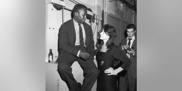 Juliette Greco and Miles Davis are pictured at the club Saint Germain in Paris in 1958.