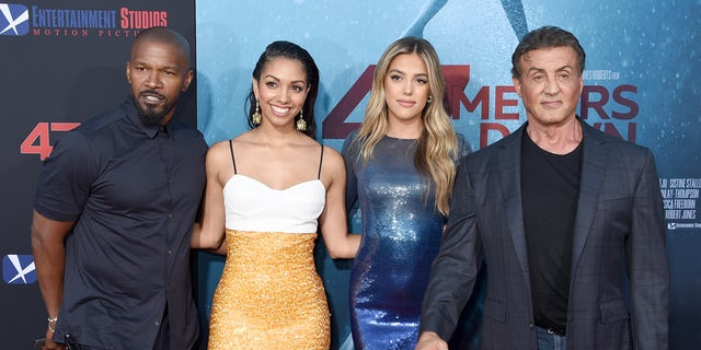 """Jamie Foxx, Corinne Foxx, Sistine Stallone, and Sylvester Stallone arrive at the LA Premiere Of Entertainment Studios' """"47 Meters Down: Uncaged"""" at Regency Village Theatre on August 13, 2019 in Westwood, Calif."""
