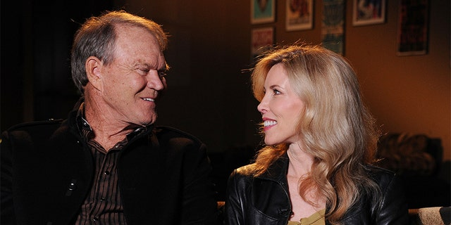 Glen Campbell and Kim Woollen sit down for an interview with CMT at the Bridgestone Arena on September 19, 2011, in Nashville, Tennessee. (Photo by Rick Diamond/Getty Images)