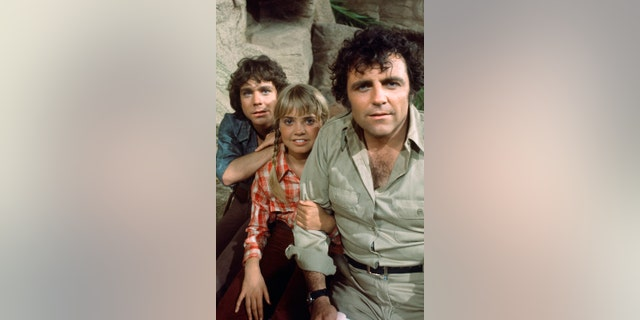 Pictured from left: Wesley Eure as Will Marshall, Kathy Coleman as Holly Marshall, Spencer Milligan as Park Ranger Rick Marshall.