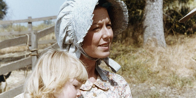 Pictured: (l-r) Brenda/Wendi Turnbaugh as Grace Ingalls, Karen Grassle as Caroline Quiner Holbrook Ingalls.