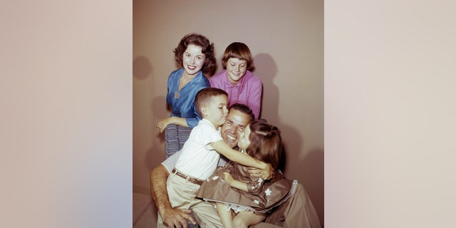 Shirley Temple, son Charles Black Jr., daughter Susan Agar, husband Charles A. Black, and daughter Lori Black at home in 1957. (Photo by Herb Ball/NBC/NBCU Photo Bank via Getty Images)