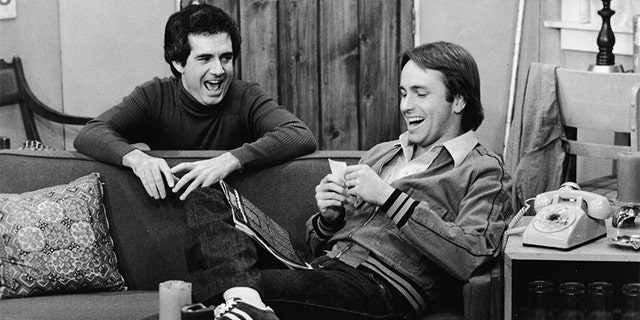 "John Ritter and Richard Kline share a laugh in a still from the television series, ""Three's Company,"" circa 1970s. (ABC Television/Courtesy of Getty Images)"