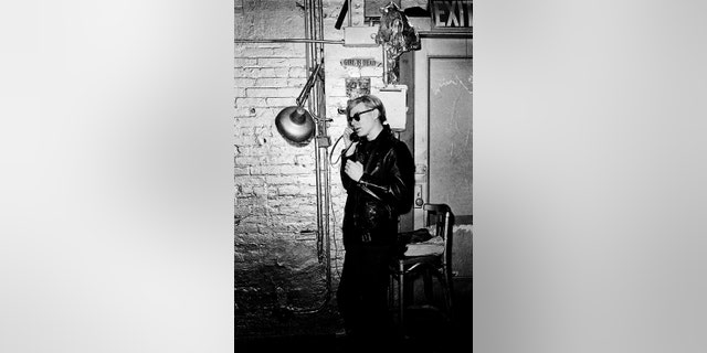 Andy Warhol at the Factory on the phone on May 5, 1968 in New York City. (Photo by Santi Visalli/Getty Images)