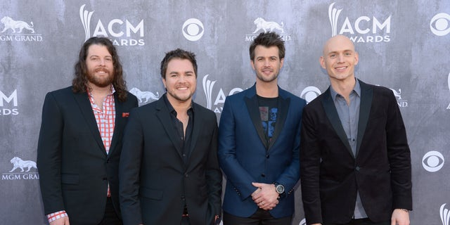 James Young, Mike Eli, Chris Thompson and Jon Jones of the Eli Young Band attend the 49th Annual Academy Of Country Music Awards at the MGM Grand Garden Arena on April 6, 2014 in Las Vegas, Nevada.