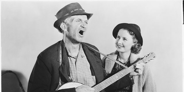 "Walter Brennan and Barbara Stanwyck in ""Banjo on My Knee."" (Photo by John Springer Collection/CORBIS/Corbis via Getty Images)"