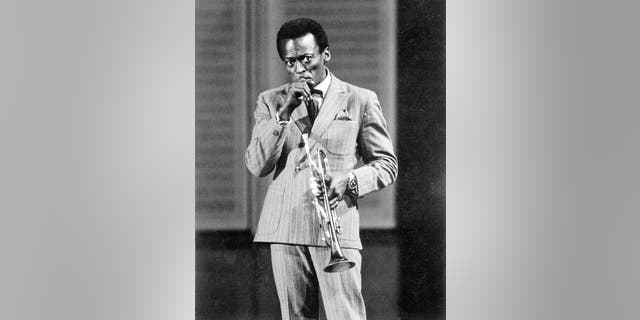 Jazz trumpeter and composer Miles Davis plays trumpet as he performs onstage in circa 1959 in West Germany. (Photo by Michael Ochs Archives/Getty Images)