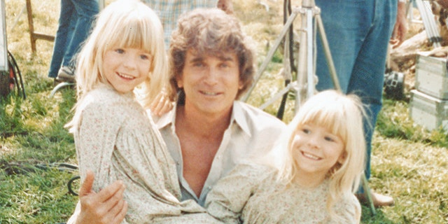 Michael Landon holding Wendi Lou Lee and her twin sister Brenda.