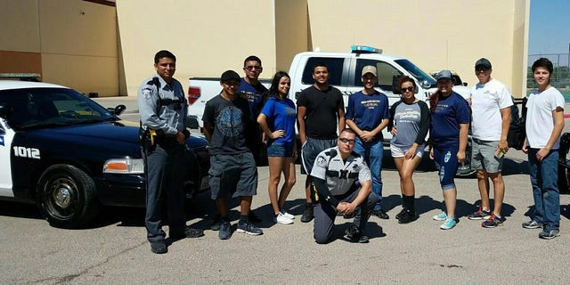 El Paso County Sheriff's Deputy Peter Herrera with teenagers he mentored.