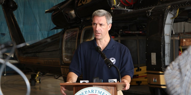 U.S. Citizenship and Immigration Services Acting Director Ken Cuccinelli addresses reporters after touring the border in McAllen, Texas. (Adam Shaw/Fox News)