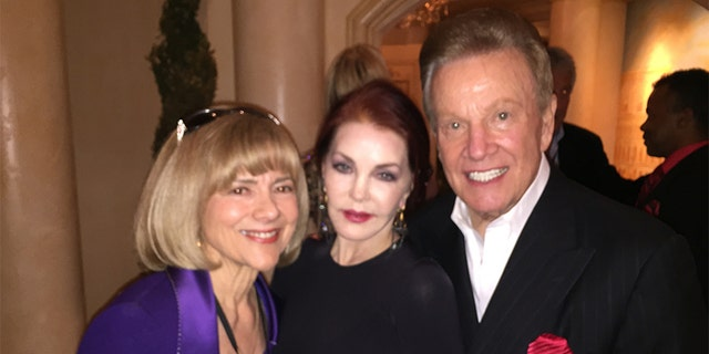 Wink Martindale (right) with Priscilla Presley (center) and the game show host's wife Sandy.
