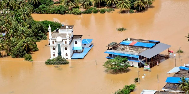 A flooded area of Malappuram district, Kerala as seen from an Indian Navy helicopter Sunday.