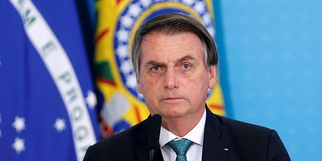 Bolsonaro threatened to punch a reporter in the face on Sunday following a question about alleged family corruption. (REUTERS/Adriano Machado, File)