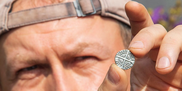 Amateur historian Jaroslaw Musialkowski who discovered over 200 14th century coins from a former military camp near the site of the Battle of Roslin, where Scottish forces led by John Comyn decimated their English counterparts in 1303. (Credit: SWNS)