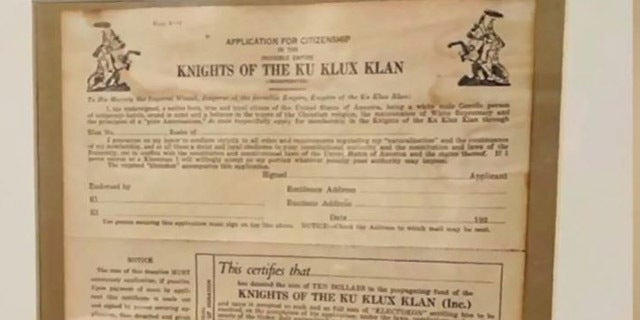 A Michigan man said he found an application to the KKK while touring a cop's home that was for sale.