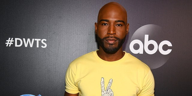 """Karamo Brown arrives at the 2019 """"Dancing With The Stars"""" Cast Reveal at Planet Hollywood Times Square on August 21, 2019 in New York City. (Photo by Dave Kotinsky/Getty Images for Planet Hollywood International)"""