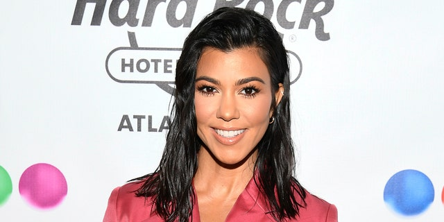 Kourtney Kardashian is receiving backlash after she publicly supported brother-in-law Kanye West's presidential campaign by sporting a 'Vote Kanye ball cap. (Photo by Dave Kotinsky/Getty Images for Sugar Factory American Brasserie)