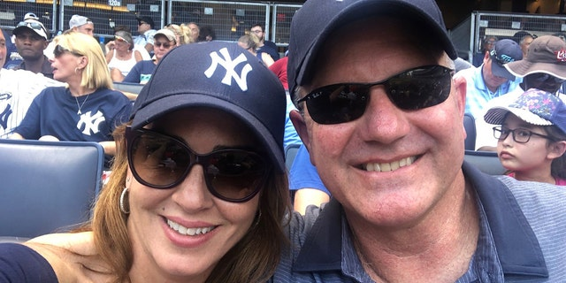 Marty Bailey, right, with his wife Sara Carter attending a game between the New York Yankees and Cleveland Indians.
