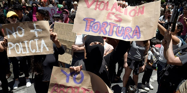 A group of activists take part in a protest called by civil organizations against the police Monday. (ALFREDO ESTRELLA/AFP/Getty Images)
