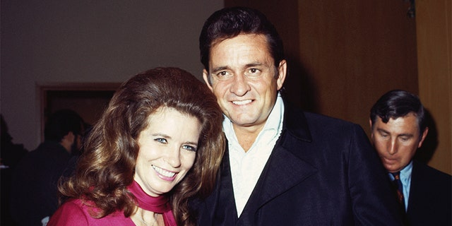Married country singers Johnny Cash and June Carter Cash pose for a portrait at an event on September 1969 in California.鈥嬧�嬧��