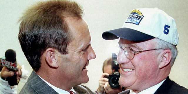 Former Kansas City Royals baseball player George Brett is congratulated by Miles Prentice after Brett was voted into the National Baseball Hall of Fame by the Baseball Writers' Association of America. Prentice nearly bought the Royals. (Photo credit should read DAVID KAUP/AFP/Getty Images)