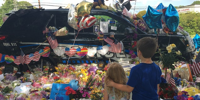 Officer Sheldon's police cruiser was decorated after his death.