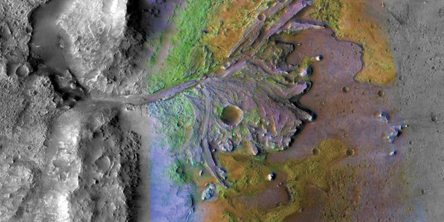 This is the landing point of Mars 2020. Chemical change from water, Jezero crater delta: On ancient Mars, water-carved channels and transported sediments for the formation of fans and deltas in lake basins (color improved to indicate mineral types). (Credit: NASA / JPL-Caltech / MSSS / JHU-APL)