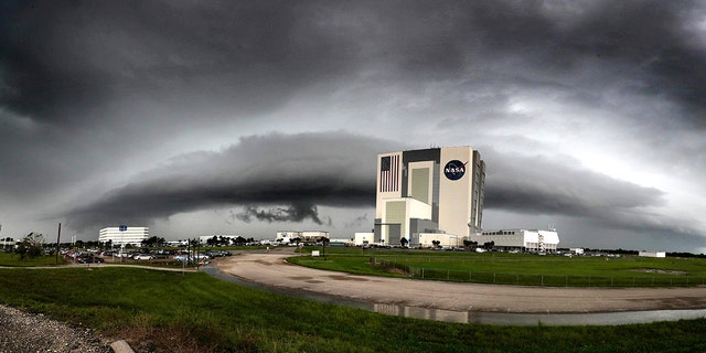 Thunderstorms flank the vehicle assembly building at the Kennedy Space Center earlier this month.