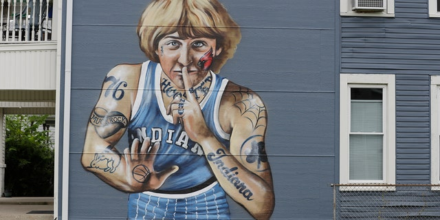 A mural of former NBA star Larry Bird is seen on the side of a multi-family residence in Fountain Square, Wednesday, Aug. 21, 2019, in Indianapolis. (AP Photo/Darron Cummings)