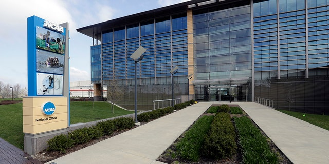 FILE - In this April 25, 2018, file photo, NCAA headquarters in Indianapolis is viewed. The NCAA has backtracked on its new agent certification standards and will no longer require a bachelor's degree for those who will be permitted to represent a student-athlete. (AP Photo/Darron Cummings, File)