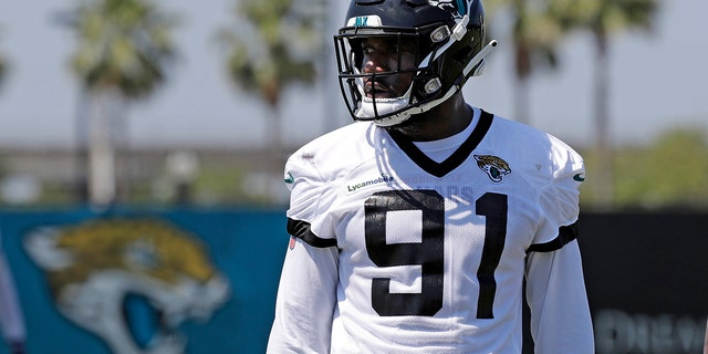 FILE - In this May 21, 2019, file photo, Jacksonville Jaguars defensive end Yannick Ngakoue (91) prepares for drills during an NFL football practice in Jacksonville, Fla. (AP Photo/John Raoux, File)