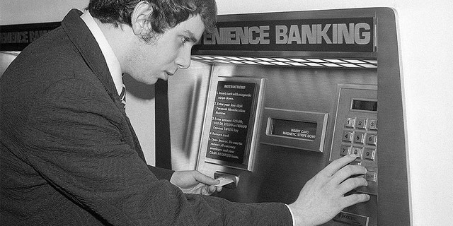 (Original Caption) 6/7/1976-New York, NY-: Banks across the nation are abandoning their old image and their bricks-and-mortar concept of doing business, and are trying to lure new customers with push-button banking. Using a coded plastic card in the computerized teller machine such as this one in Grand Central Station, a customer can deposit or withdraw money, transfer funds, and even make a loan. (Bettmann/Getty)