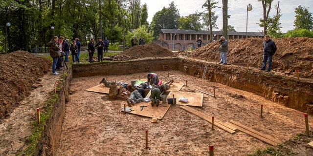 Archaeologists work on July 7, 2019 at a site of the burial place of French General Charles Etienne Gudin de la Sablonniere.