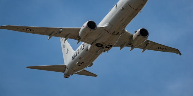 """File photo - A P-8A Poseidon maritime patrol and reconnaissance aircraft from the """"Golden Eagles"""" of Patrol Squadron (VP) 9 performs a flyover at an airshow during SB19 in Mykolaiv, Ukraine, July 9, 2019. (U.S. Navy photo by Mass Communication Specialist 3rd Class T. Logan Keown/Released)"""