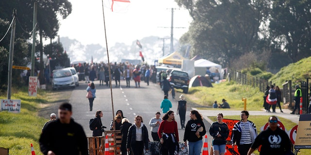 Protestors gather at Ihumātao as they stand to fight a proposed Fletcher Building housing development on July 25, 2019 in Auckland, New Zealand. The site near Auckland Airport is due to be developed by Fletcher Building but has been the subject of a dispute and an occupation after an eviction notice was served against occupiers earlier in the week.