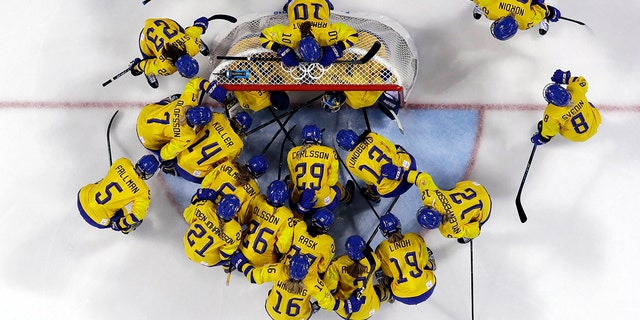 FILE - In this Feb. 2, 2018, file photo, players from Sweden gather before the preliminary round of the women's hockey game against the combined Koreas at the 2018 Winter Olympics in Gangneung, South Korea. (AP Photo/Kiichiro Sato, File)