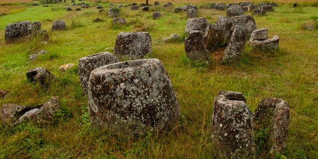 The Plain of Jars, seen in this undated file photo, consists of thousands of stone jars scattered around the upland valleys and the lower foothills of the central plain of the Xiangkhoang Plateau in Laos and is dated to the Iron Age (500 BC to AD 500). It is one of the most important prehistoric sites in Southeast Asia. (Photo by: Avalon/Universal Images Group via Getty Images)