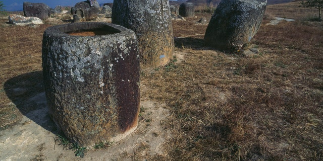 Jars in sandstone in the archaeological site of the Plain of Jars, plateau of Xiang Khoang, Laos.