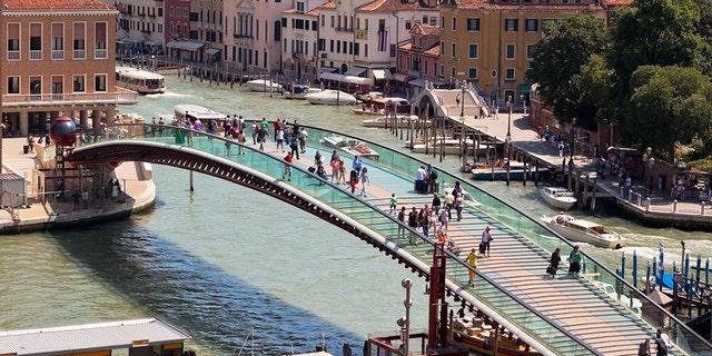 Venice, Italy - June 13, 2013: Venice cityscape and The Constitution Bridge (Ponte della Costituzione) over the Grand canal from above.