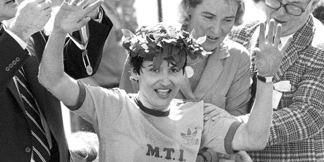 FILE - In this April 21, 1980 file photo, Rosie Ruiz waves to the crowd after after being announced as winner of the women's division of the Boston Marathon in Boston. Her title was stripped eight days later when it was found that she had not run the entire course. Ruiz died July 8, 2019 in Florida. She was 66. (AP Photo/File)