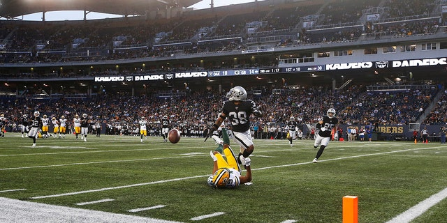 Green Bay Packers' Equanimeous St. Brown (19) misses the pass in the modified end zone as Oakland Raiders' Keisean Nixon (38) defends during the first half of an NFL preseason football game Thursday, Aug. 22, 2019, in Winnipeg, Manitoba. (Associated Press)