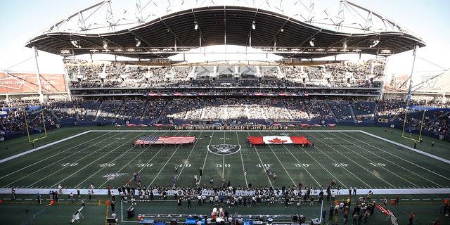 U.S. and Canadian flags are presented on the field before an NFL preseason football game between the Green Bay Packers and the Oakland Raiders on Thursday, Aug. 22, 2019, in Winnipeg, Manitoba. (Associated Press)