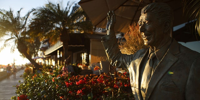 A statue of former President Ronald Reagan in front of a home on Orange County's Balboa Island in Newport Beach, California, in 2018. (Mario Tama/Getty Images, File)