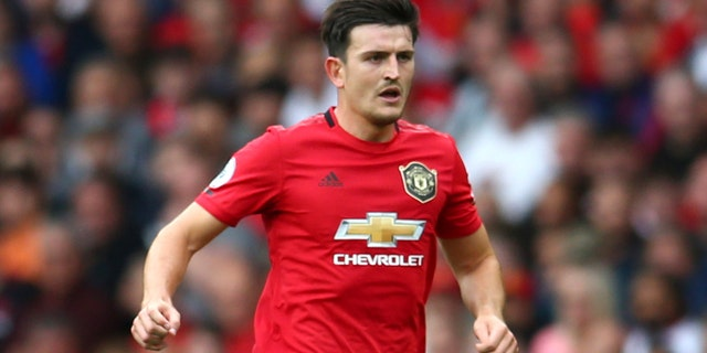 Manchester United's Harry Maguire controls the ball during the English Premier League soccer match between Manchester United and Chelsea at Old Trafford in Manchester, England, Sunday, Aug. 11, 2019. (AP Photo/Dave Thompson)