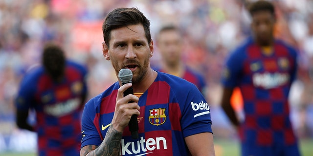 Barcelona forward Lionel Messi addresses the crowd prior of the Joan Gamper trophy soccer match between FC Barcelona and Arsenal at the Camp Nou stadium in Barcelona, Spain, Sunday, Aug. 4, 2019. (AP Photo/Joan Monfort)