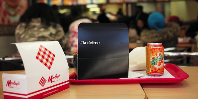 Britain's government is facing severe backlash for making a campaign to reduce knife crime with an advertisement on fried chicken boxes, according to reports. (Home Office)