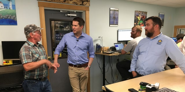 Rep. Seth Moulton of Massachusetts, a Democratic presidential candidate, meets with employees of solar power company Revision Energy, at the offices in Brentwood, NH on August 7, 2019